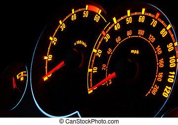 Backlit car dashboard dials glowing at night - Back lit...
