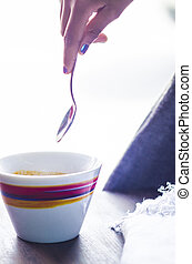 backlit cup of coffee with spoon - colorful cup full of ...