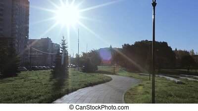 Backlit sun and walkway with lanterns. Children's Landscape...