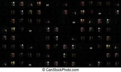 Backlit Windows of an Apartment Complex at Night - FullHD...