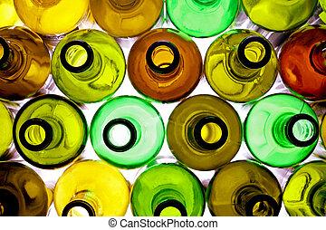 backlited bottles - stack of assorted empty wine bottles ...