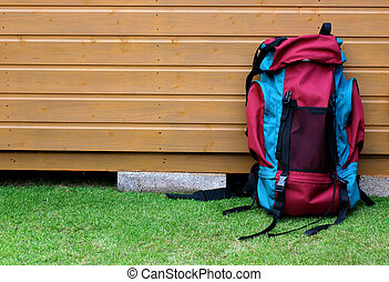 Backpack against a cabin wall