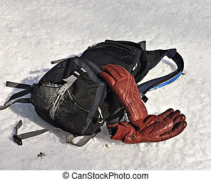 Backpack and Gloves in the Snow