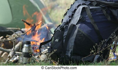 Backpack by campfire