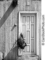 Backpack hanging on a wooden vintage door