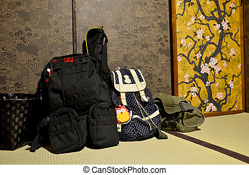 Backpack of traveler put down at room japanese style of...