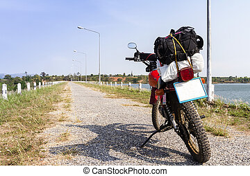 Backpack on motorbike ready to go