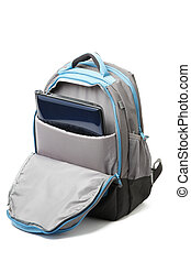 Backpack with a laptop inside isolated on white background