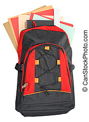 A black and red backpack with school material over a white background