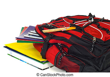 Backpack with supplies - Red backpack overflowing with...