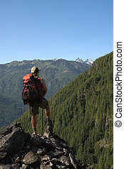 Backpacker at a lookout - A lone male backpacker enjoys the...
