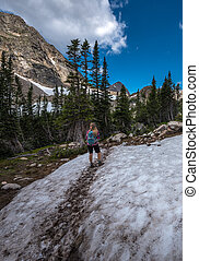 Backpacker entering the Valley near Blue lake Colorado Indian peaks wilderness