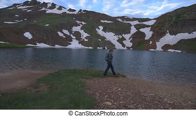 Backpacker Girl walks near  Lake Como Colorado USA