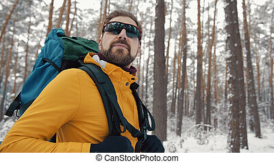 Backpacker in winter woods portrait