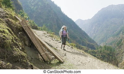 Backpacker on the nepalese path around the Manaslu mountain...