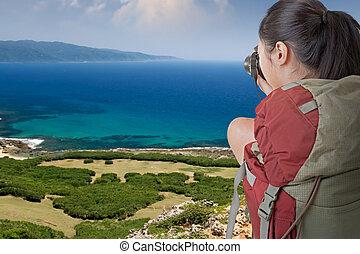 backpacker take photo - Asian female backpacker take photo...