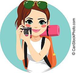 Backpacker Woman Holding Camera