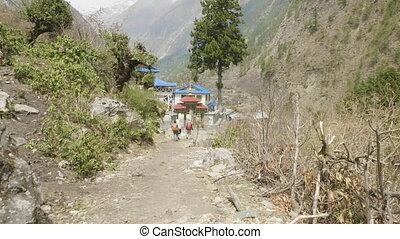 Backpackers in nepalese trekking around the Manaclu mountain...