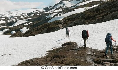 Backpackers in the snowy mountains. Norway