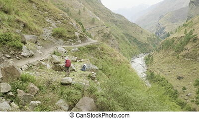 Backpackers on the nepalese path around the Manaslu mountain...