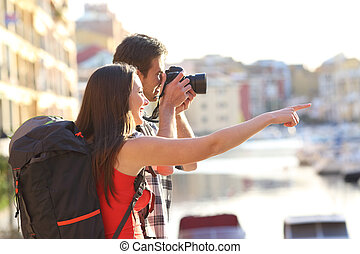 Backpackers taking photos on summer vacation