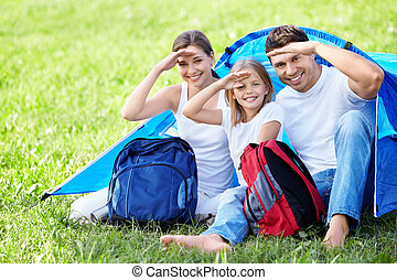 Backpacking - Smiling family with a backpack tent