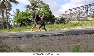 Backpacking Tourists Walking on Cemented Road in Africa