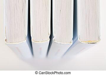 Backs of four books
