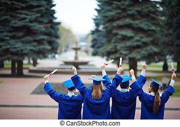 Backs of graduates
