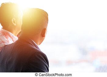 Backside businessman speaking together.