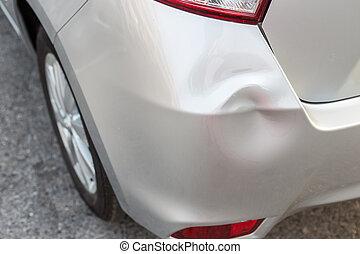 Backside of silver car get damaged by accident - Backside of...
