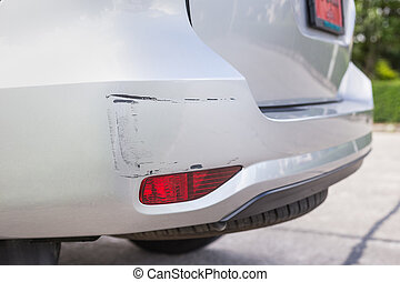 Backside of silver SUV car get scratched, damaged by...