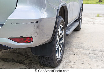 Backside of  silver SUV car get scratched, damaged by accident