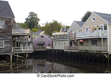 Backside of wooden houses over water