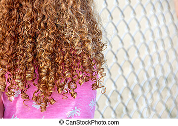 little girl with curly red hair