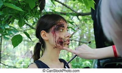 Backstage of applying makeup for the zombie apocalypse...