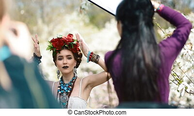 Backstage of ethnic photoshoot outdoor.