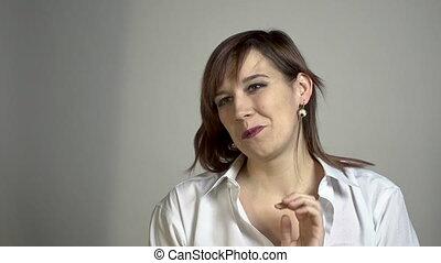 Backstage of photo session brunette model on gray background