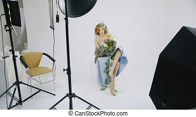 Backstage studio work - Fashion model with a bouquet of...