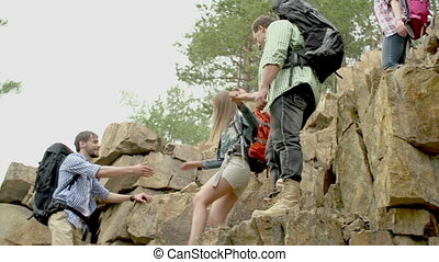 Backup - Guys supporting their girlfriends during steep rock...