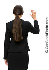 Backview of business woman waving hand