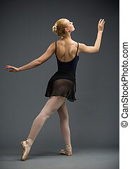 Backview of dancing ballerina