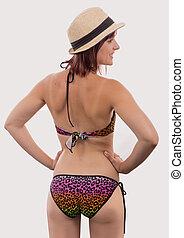 Backview of female wearing bikini, isolated on white.