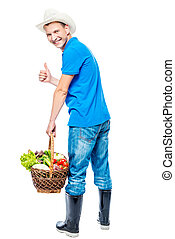 Backward farmer with a basket of vegetables on a white background