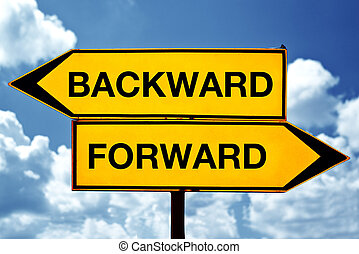 Backward or forward opposite signs. Two opposite signs against blue sky background.