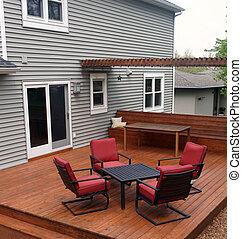 Backyard Deck - Backyard deck with furniture.