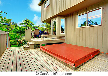 Spacious two level backyard deck. Patio area on the first level and jacuzzi is on the second one
