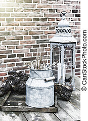 Backyard decoration with vintage milk can and lantern