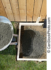 Backyard, DIY concreting project with wet cement