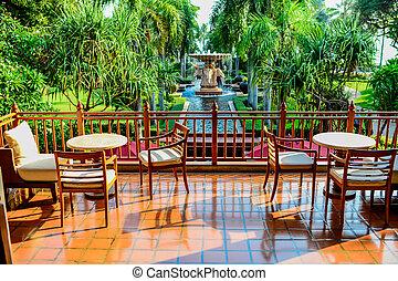 Backyard facing to fountain in sunny day.